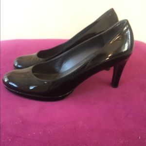 Stuart Weitzman Patent Leather Round Toe Pump.